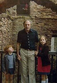 APPARITION: A figure can be seen looking through the window in the background of Grace Lamb's photo of her late husband Hugh and children Paul and Kelly on a visit to Tantallon Castle