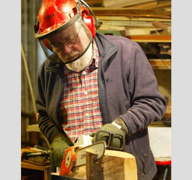 John Adamson at work in his basement workshop/gallery