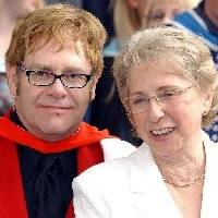 GETTING RID: Elton John's mum Sheila Farebrother pictured with Elton as he receives an Honorary Doctorate from the Royal Academy of Music in 2002