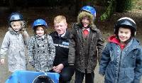 PUPILS from Riddings Junior School get to grips with a special JumicarÙ as part of a scheme aimed at teaching children the dangers of the road.