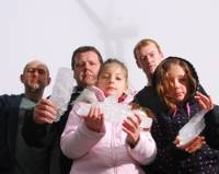 Pictured, from left, are Peter Randall, Tyson Clark and Andrew Randall with Sophia Nesbitt (10) and Tia Clark (10) with some of the blocks of ice which have fallen off the nearby wind turbine. (8GM1129018) Picture: Georgi Mabee