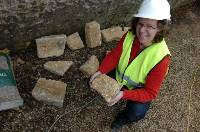 Archaeologist Dr Jackie Hall with a rare find of Anglo-Saxon grave markers discovered during repairs to a wall in the cathedral precincts.(8PF0228118) Picture: PAUL FRANKS