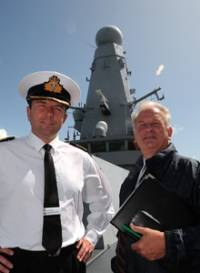 HMS Daring Captain Paddy McAlpine with Historic Dockyard chief executive Robert Bruce