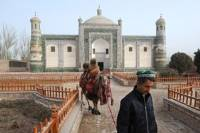 A Chinese Muslim Uighur man leads a camel past a Kashgar temple. Uighurs are angry at claims that they support global jihad and say they only want independence from Beijing Picture: AFP Photo