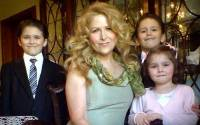 Theresa Riggi pictured with her children before the tragic events took place
