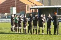 The goth and Gazette teams mark a minute's applause in tribute to Sophie before the football match
