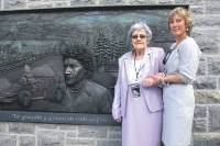 Tom Pryce's widow Nella and his mum, Gwyneth, unveils the memorial at its site on the junction of Clwyd Street and Upper Clwyd Street, Ruthin.