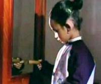 A child holds a stick of dynamite in a scene from the DVD. Click PLAY to watch the footage