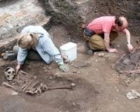 THE TRENCHES: Kurt Hunter-Mann, a field officer at York Archaeological Trust, examines a skeleton at the Roman site.