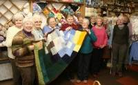 The knitting group members with their blanket