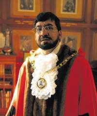 CHARGED: Former Mayor of Peterborough Raja Akhtar and, inset, Mohammed Choudhary, who are both now facing charges relating to alleged vote rigging.