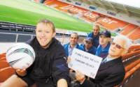 VISIT: Percy Pyle at the Keepmoat Stadium with Doncaster Rovers in the Community officer Richard Bailey, front. With them are Park Care team l-r Rik Shipley, director, driver Ian Constable, manager Trevor Boswell and driver David Wooley.         Picture: MARIE CALEY D8750MC