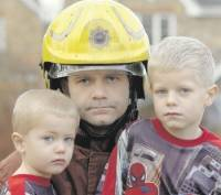 Turned away: Firefighter Phillip Smith and his two sons Aiden 3, and Jake 5    Picture: Mike Waistell